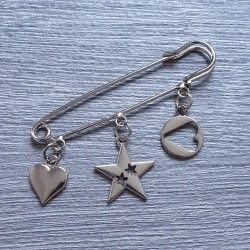 Decorative pin with charms, silver