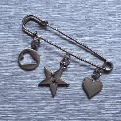 Decorative pin with charms, black metal